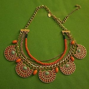 Charming Charlie Corral and gold statement piece.